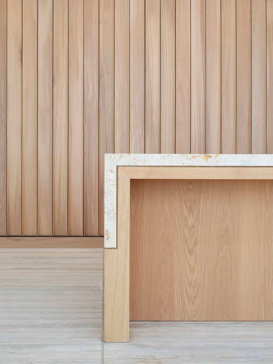 Fluted wall panelling and reception desk