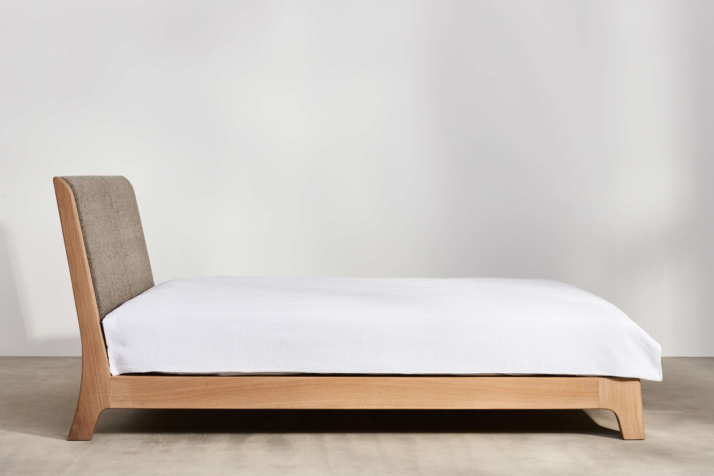 oak bed with upholstered headboard
