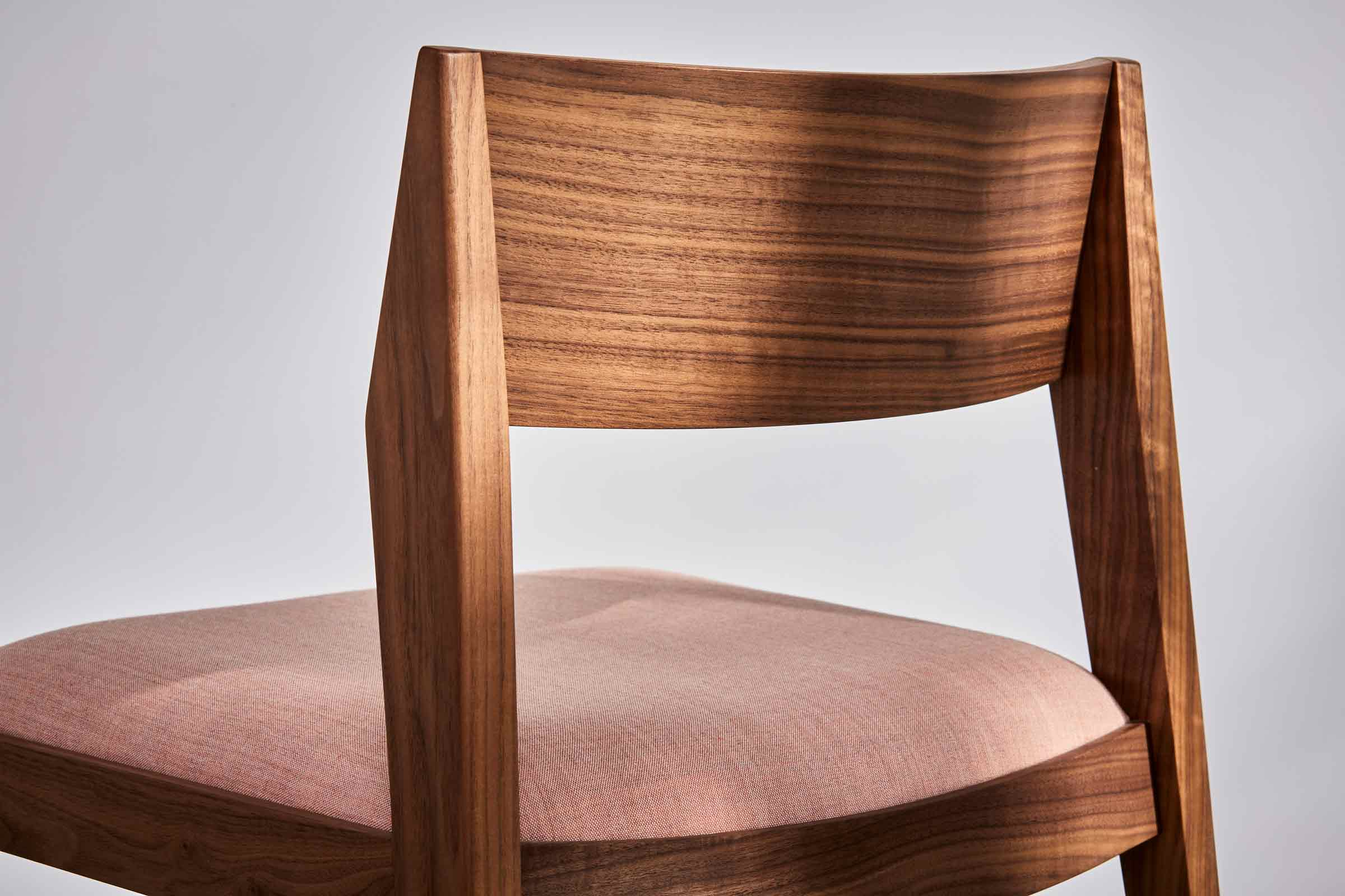walnut side chair with a pink colour seatpad